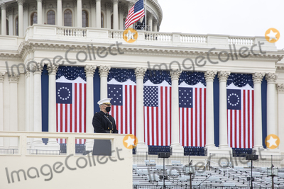 Photo - A member of the Military Honor Guard is seen during a dress rehearsal ahead of the 59th Inaugural Ceremonies on the West Front of the US Capitol in Washington DC US Monday Jan 18 2021 Biden ascends to the presidency on Wednesday with an inaugural speech outlining how hell tackle the health and economic crises he inherits while attempting to knit the country back together just two weeks after the outgoing presidents loyalists waged a deadly riot to block the change of power Credit Jeenah Moon  Pool via CNPAdMedia