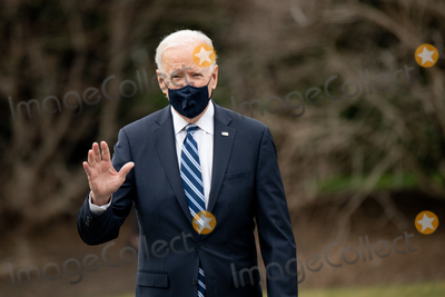 Photos From U.S. President Joe Biden waves as he walks on the South Lawn of the White House before boarding Marine One in Washington