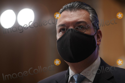 Alex Padilla Photo - United States Senator Alex Padilla (Democrat of California)  wears a protective mask during a Senate Homeland Security and Governmental Affairs Committee confirmation hearing for Neera Tanden director of the Office and Management and Budget (OMB) nominee for US President Joe Biden in Washington DC US on Tuesday Feb 9 2021 Tanden who pledged to work with both parties after drawing sharp criticism from Republicans for sniping at them on social media worked on the Affordable Care Act during the Obama years and was an aide to Hillary Clinton from her time as first ladyCredit Ting Shen  Pool via CNPAdMedia