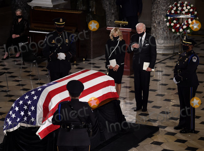 Photo - Former United States Vice President and Democratic presidential nominee Joe Biden and his wife Jill Biden pay their respects to the late Associate Justice Ruth Bader Ginsburg as her casket lies in state during a memorial service in her honor in the Statuary Hall of the US Capitol September 25 2020 in Washington DCCredit Olivier Douliery  Pool via CNPAdMedia
