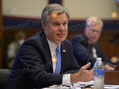 Photo - FBI Director Christopher Wray left  testifies as Christopher Miller of the National Counterterrorism Center right is on hand to testify at the House Committee on Homeland Security in Washington DC  on September 17 2020Credit John McDonnell   Pool via CNPAdMedia
