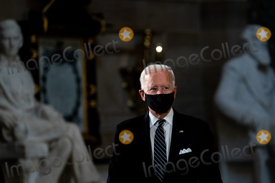 Photo - Former United States Vice President Joe Biden the Democratic Party candidate for President attends a ceremony where Justice Ruth Bader Ginsburg lies in state in Statuary Hall of the Capitol in Washington DC on September 25 2020 Credit Erin Schaff  Pool via CNPAdMedia