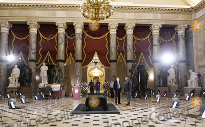 Photo - Final preparations are being made in Statuary Hall  of the US Capitol in Washington Friday Sept 25 2020 for Justice Ruth Bader Ginsburg who will lie in state later today  Her flag-draped casket will lie atop the Lincoln Catafalque a bier built for the funeral of President Abraham Lincoln Credit Alex Brandon  Pool via CNPAdMedia