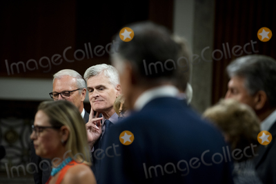 Photo - United States Senator Bill Cassidy (Republican of Louisiana) third from left listens while United States Senator Kyrsten Sinema (Democrat of Arizona) left makes remarks after the vote on the motion to invoke cloture to proceed to the consideration of HR 3684 the INVEST in America Act on Capitol Hill in Washington DC on Wednesday July 28 2021 The vote to begin discussion of the bipartisan infrastructure bill agreed to by the White House was 67 to 32 If passed the bill would invest close to 1 trillion in roads bridges ports and other infrastructure without a major tax increaseCredit Rod Lamkey  CNPAdMedia