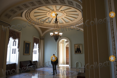 Photos From United States Senator Lindsey Graham (Republican of South Carolina) walks alone in the hallway outside the Senate chamber following a private conversation with United States Senator Bob Menendez (Democrat of New Jersey) at the U.S. Capitol