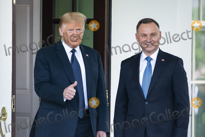Photo - US President Donald J Trump (L) welcomes  Polish President Andrzej Duda (R) to the White House in Washington DC USA 24 June 2020 Duda a conservative nationalist facing a tight re-election back home is the first foreign leader to visit the White House in more than three monthsCredit Jim LoScalzo  Pool via CNPAdMedia