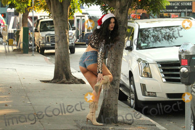 Photo - Natasha Blasick spotted in shorts with a candy cane holster