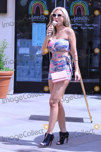 Photo - Brazilian PLaymate Ana Braga in a skimpy outfit having ice cream