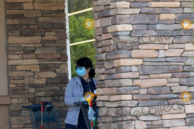 San Bernardino Photo - LOS ANGELES - APR 11  Aldi employee cleaning carts at the Businesses reacting to COVID-19 at the Hospitality Lane on April 11 2020 in San Bernardino CA