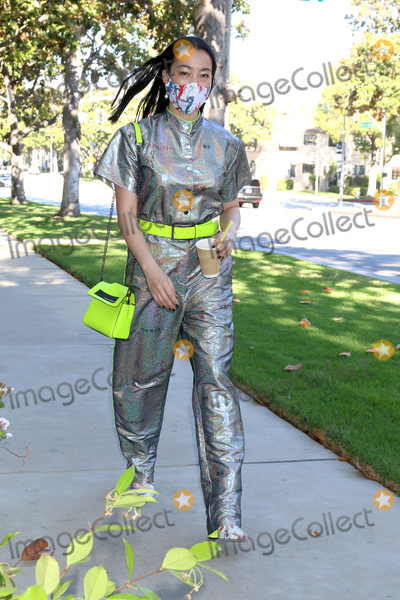 Photo - Yi Zhou out and about in outfit mask shoes and accessories by