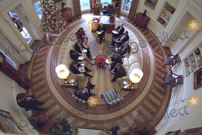 Andy Card Photo - United States President George W Bush hosts a meeting with his domestic policy staff in the Oval Office of the White House in Washington DC decorated with the new presidential rug on Thursday December 20 2001 The rug which is unique to the Bush administration arrived earlier in the week and was unveiled to the media on Friday December 21 2001 Members from the Office of Homeland Security and other White House staff attended the meeting The participants included (clockwise from the bottom) President George W Bush Governor Tom Ridge Dr Condoleezza Rice Admiral Steve Abbot Karen Hughes Dean McGrath Karl Rove Albert Hawkins Mitch Daniels Josh Bolton and Andy Card White House Photographer Paul Morse is at leftMandatory Credit Paul Morse - White House via CNP