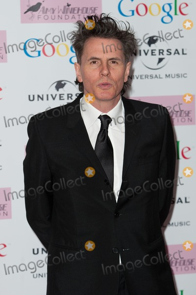 Jonh Taylor Photo - Jonh Taylor arriving for the Amy Winehouse Foundation Dinner London 20112013 Picture by Dave Norton  Featureflash