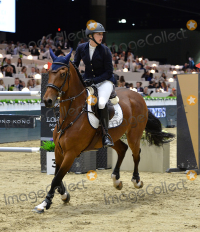 Audrey Coulter Photo - Audrey Coulter (USA) riding Domino at the Gucci Gold Cup International Jumping competition at the 2015 Longines Masters Los Angeles at the LA Convention CentreOctober 3 2015  Los Angeles CAPicture Paul Smith  Featureflash