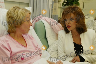 Alison Miller Photo - London Joan Collins and Mrs Alison Miller (cancer patient) takes on new role as tea lady at the Royal Marsden Hospital  The British born star of TV shows like Dynasty  was there to support the hospitals 30 million cancer campaign to instal new facilities at the Royal Marsden 22nd March 2004 JENNY ROBERTSLANDMARK MEDIA