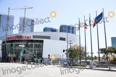 Angel City Photo - LOS ANGELES CALIFORNIA USA - MARCH 26 STAPLES Center and Flags of the United States California Republic County of Los Angeles City of Los Angeles and Los Angeles Convention Center displayed at Los Angeles Convention Center which are temporarily closed amid the coronavirus COVID-19 pandemic after the Safer at Home order issued by both Los Angeles Mayor Eric Garcetti at the county level and California Governor Gavin Newsom at the state level on Thursday March 19 2020 which will stay in effect until at least April 19 2020 March 26 2020 in Los Angeles California United States (Photo by Xavier CollinImage Press Agency)