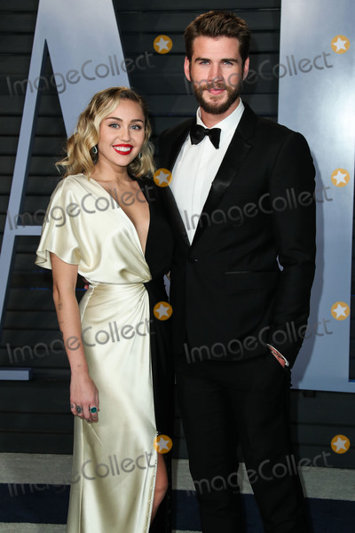 Photos From (FILE) Miley Cyrus and Liam Hemsworth Appear to Be Married