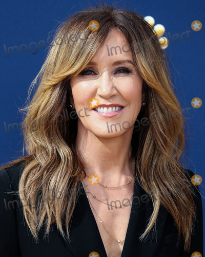 Photos From (FILE) Felicity Huffman charged in college admissions cheating scheme