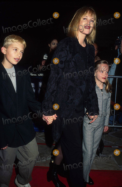 Alexander Bauer Photo - Melanie Griffith with Her Son Alexander Bauer and Daughter Dakota Johnson at Sphere Premiere in Village Theatre  CA 1998 Photo by Phil Roach-ipol-Globe Photos Inc
