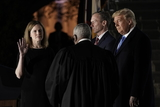 Supremes Photo - Associate Justice of the Supreme Court Clarence Thomas administers the oath of office to Judge Amy Coney Barrett to be Associate Justice of the Supreme Court on the South Lawn of the White House in Washington DC on Monday October 26 2020  US President Donald J Trump and her husband Jesse M Barrett look onCredit Ken Cedeno  Pool via CNPAdMedia
