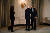 The Specials Photo - John Kerry the Special Presidential Envoy for Climate greets President Joe Biden and Vice President Kamala Harris before the start of an event on the administrations response to climate change at an event in the State Dining Room of the White House in Washington DC January 27th 2021 Credit Anna Moneymaker  Pool via CNPAdMedia