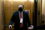 Donald Trump Photo - Jason Miller former senior advisor to 2020 Trump campaign wears a protective mask while arriving to the US Capitol in Washington DC US on Saturday Feb 13 2021 The Senate voted to consider a request for witnesses at Donald Trumps impeachment trial injecting a chaotic new element that could end up prolonging proceedings that appeared to be on track to wrap up today Credit Stefani Reynolds - Pool via CNPAdMedia