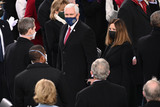 Mike Pence Photo - Outgoing US Vice President Mike Pence and US Second Lady Karen Pence arrive before US President-elect Joe Biden is sworn in as the 46th US President on January 20 2021 at the US Capitol in Washington DC - Biden a 78-year-old former vice president and longtime senator takes the oath of office at noon (1700 GMT) on the US Capitols western front the very spot where pro-Trump rioters clashed with police two weeks ago before storming Congress in a deadly insurrection (Photo by Saul LOEB  POOL  AFP)AdMedia