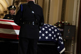 Alex Wong Photo - Honor guard stand next to the flag-draped casket of United States Representative Elijah Cummings (Democrat of Maryland) as the late congressman lies in state outside the US House chamber at the US Capitol October 24 2019 in Washington DC Rep Cummings passed away on October 17 2019 at the age of 68 from complications concerning longstanding health challenges  Credit Alex Wong  Pool via CNPAdMedia