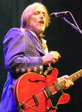 Tom Petty  the Heartbreakers Photo - 02 October 2017 - Tom Petty whose Florida-bred quintet the Heartbreakers was one of the defining arena-rock acts of the 1970s with hits like Breakdown has died after suffering a heart attack Sunday at his home He was 66 American musician singer songwriter multi instrumentalist and record producer He is best known as the lead singer of Tom Petty and the Heartbreakers but is also known as a member and co-founder of the late 1980s supergroup the Traveling Wilburys (under the pseudonyms of Charlie T Wilbury Jr and Muddy Wilbury) and his early band Mudcrutch Petty has recorded a number of hit singles with the Heartbreakers and as a solo artist many of which are mainstays on adult contemporary and classic rock radio In 2002 Petty was inducted into the Rock and Roll Hall of Fame File Photo Jul 10 2001 Pittsburgh PA USA Newlywed singer TOM PETTY  the Heartbreakers perform for a sold-out audience Petty married Dana York June 3rd 2001 Photo Credit Laura FarrAdMedia