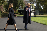 Alabama Photo - US President Donald J Trump (R) waves beside First Lady Melania Trump (L) as they walk aross the South Lawn of the White House to depart by Marine One in Washington DC USA 09 November 2019 The President and First Lady will attend a National Collegiate Athletic Association (NCAA) football game between Alabama and Louisiana State University in Tuscaloosa Alabama then they will stay in New York City through Veterans DayCredit Michael Reynolds  Pool via CNPAdMedia