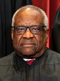 Supreme Court Photo - Associate Justice of the Supreme Court Clarence Thomas sits during a group photo of the Justices at the Supreme Court in Washington DC on April 23 2021 Credit Erin Schaff  Pool via CNPAdMedia