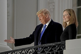 Supremes Photo - United States President Donald J Trump gestures to guests as he and Justice Amy Coney Barrett pose for photos following the ceremony where she took the oath of office to be Associate Justice of the Supreme Court on the Blue Room Balcony of the White House in Washington DC US October 26 2020 Credit Ken Cedeno  Pool via CNPAdMedia