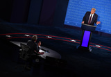 Presidential Campaign Photo - United States President Donald J Trump speaks with moderator Chris Wallace during the first of three scheduled 90 minute presidential debates with Democratic presidential nominee Joe Biden in Cleveland Ohio on Tuesday September 29 2020Credit Kevin Dietsch  Pool via CNPAdMedia