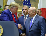 The Used Photo - United States President Donald J Trump shakes hands with Zippy Duvall President and CEO American Farm Bureau Federation as he makes remarks prior to the signing ceremony for the US-Japan Trade Agreement and US-Japan Digital Trade Agreement in the Roosevelt Room of the White House in Washington DC on Monday October 7 2019 Photo Credit Ron SachsCNPAdMedia