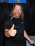 Jim Duggan Photo - 01 October 2017 - Hamilton Ontario Canada  WWE Hall of Fame wrestler Hacksaw Jim Duggan at Hamilton Comic Con at the Canadian Warplane Heritage Museum Photo Credit Brent PerniacAdMedia