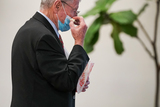 Train Photo - Sen James Inhofe (R-Okla) eats popcorn as he waits for a subway train in the Capitol during a brief recess in the second day of the impeachment trial of former President Donald Trump on Wednesday February 10 2021Credit Greg Nash - Pool via CNPAdMedia