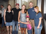 Rhett Akins Photo - August 16 2011 - Athens GA - Rhett Akins with the family of slain officer Elmer Buddy Christian Country artist Colt Ford rounded up his songwriter and artist friends to hold a benefit for the family of Elmer Buddy Christian an Athens Police Officer who died in the line of duty  Prior to the show Colt and friends met fans at a VIP party  Photo credit Dan HarrAdMedia