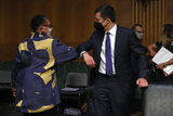 Pete Buttigieg Photo - WASHINGTON DC - APRIL 20 United States Secretary of Housing and Urban Development Marcia Fudge (L) and US Secretary of Transportation Pete Buttigieg greet one another before testifying to the Senate Appropriations Committee in the Dirksen Senate Office Building on Capitol Hill on April 20 2021 in Washington DC Members of President Bidens cabinet are testifying about the American Jobs Plan the administrations 23 trillion infrastructure plan that has yet to win over a single Republican in Congress Credit Chip Somodevilla   Pool via CNP