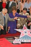 Judge Judy Sheindlin Photo - Johnny Grant with Judge Judy Sheindlin and Leron Gublerat the Ceremony honoring Judge Judy Sheindlin with a star on the Hollywood Walk of Fame Hollywood Boulevard Hollywood CA 02-14-06