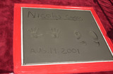 Nicolas Cage Photo -  Nicolas Cages handprints at the handprintfootprint ceremony for Nicolas Cage at the Chinese Theater Hollywood 08-14-01