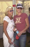 Johnny Carson Photo - Charlize Theron and mother Gerda at the Best Friends Animal Sanctuary Pet Adoption Festival at Johnny Carson Park Burbank CA 09-14-02