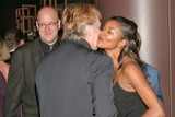 Alan Rickman Photo - Gabrielle Union and  Alan Rickman with Producer Eric Hetzel at the Los Angeles Premiere HBO Films Something The Lord Made at the Directors Guild of America Los Angeles CA 05-20-04