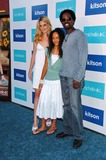 Aurora Photo - Brittany Perrineau with Harold Perrineau and their daughter Auroraat the party celebrating the launch of the New Face of Michelle K Footwear Kitson Boutique West Hollywood CA 06-15-06