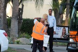 Proof Photo - Nadeea VolianovaResponds To Her Billionaire Suitors from her sign stunt earlier this year by going to the street with a new sign this time asking for proof that those who responded are really wealthy Los Angeles CA 02-26-15