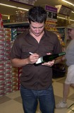Andrew Firestone Photo - Andrew Firestone autographs a bottle of wine at Pavilions in West Hollywood Making an appearance to promote his familys vineyard label West Hollywood CA 08-11-03