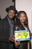 Angela Bassett Photo - Angela Bassett and hubby Courtney Vance at Motorolas 3rd Annual Holiday Party to benefit Toys for Tots Highlands Nightclub Hollywood 12-06-01