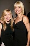 Ashley Drane Photo - Ashley Drane and Rena Riffel at the debut of actress Heidi Jayne Netzleys Art Exhibit Edgemar Center for the Performing Arts Santa Monica CA 08-08-04