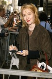 Ann Cusack Photo - Ann Cusack at Quaids induction into the Hollywood Walk of Fame on the very spot where he first set foot in Hollywood CA 10-07-03