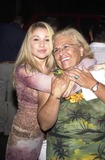 Alyssa Milano Photo - Elizabeth Daily and mother at a photography show and auction Picturing A New South Africa Featuring work by Alyssa Milano Track 16 Gallery Bergamont Station Santa Monica CA 08-10-02