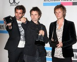 Christopher Wolstenholme Photo - LOS ANGELES - NOV 21  Muse - Christopher Wolstenholme Matthew Bellamy and Dominic Howard in the Press Room of the 2010 American Music Awards at Nokia Theater on November 21 2010 in Los Angeles CA