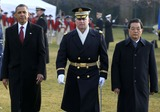 Alex Wong Photo - WASHINGTON DC - JANUARY 19 (AFP OUT) US President Barack Obama (L) and Chinese President Hu Jintao (R) inspect the honor guards as they participate during a state arrival ceremony at the South Lawn of the White House January 19 2011 in Washington DC Hu and President Obama will hold a press conference at the White House later today Photo by  Alex WongPoolCNP-PHOTOlinknet